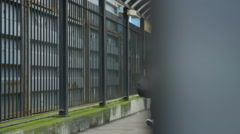 4K Serious man walking alone, away from railway station. - stock footage