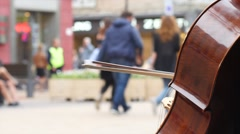 Busker playing the cello - street performer playing for money in Sofia Stock Footage