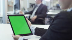 Female Woman Worker is Holding Tablet with Green Screen. Great for Mockup Usage. Stock Footage