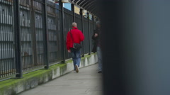 4K Serious man walking alone, away from railway station. Stock Footage