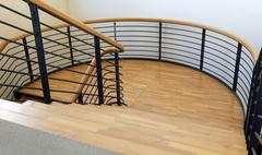 Wood and steel stairway in a modern building with parquet Stock Photos