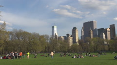 People enjoy sunny day Central Park Manhattan downtown New York City green place Stock Footage