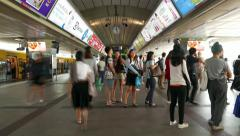 Siam BTS station crowded, commuters bustle queueing on platform timelapse shot Stock Footage