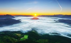 sunrise in Aramaio valley with morning fog - stock photo