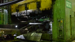 TOGLIATTI - SEP 30: Man puts component under press machine AutoVAZ factory Stock Footage