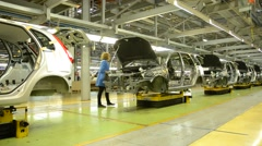 People work at assembly of cars Lada Kalina on conveyor of factory AutoVAZ Arkistovideo
