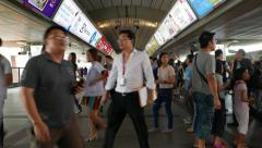Overcrowded modern metro station train arrive asian passengers struggle about Stock Footage