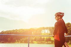Young woman riding  a bicycle with retro colors. - stock photo