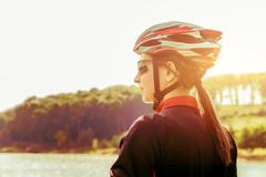 Young woman riding  a bicycle with retro colors. Stock Photos