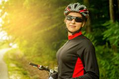 Stock Photo of Happy Young Woman riding bicycle