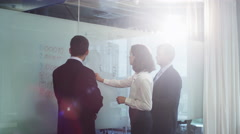 Team of Office Workers have Discussion near Glass Whiteboard - stock footage