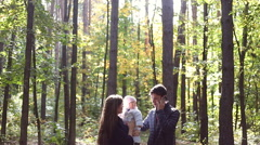 Family walk in the nature in autumn.Weekend outdoors in the woods Stock Footage