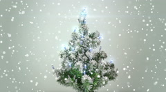Christmas tree and turbulent snowfall loop 4k (4096x2304) Stock Footage