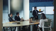 Businessman have Presentation for Group of Business People in Conference Room - stock footage