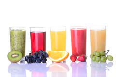 Fruit juice ( grape , strawberries , orange , kiwi ) Stock Photos