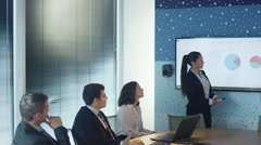 Businesswoman have Presentation for Group of Business People in Conference Room - stock footage