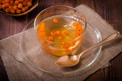 Tea with sea buckthorn - stock photo