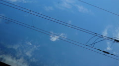 Overhead Electrical Railroad Power Line Blue Sky Stock Footage