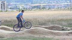 Sport biking on the uneven track among young people slow motion - stock footage