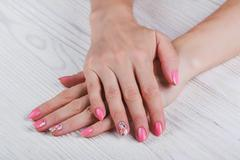 Light pink nail art with printed flowers Stock Photos