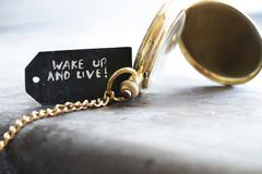 wake up and live and pocket watch - stock photo