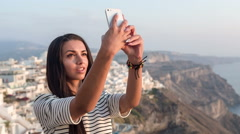 Beautiful girl doing a selfie and sending it in a text message Stock Footage