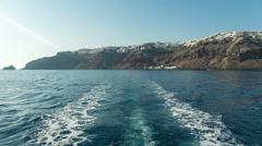 View from the back of the boat leaving an island Stock Footage