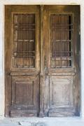 Old brown ragged shabby wooden door Stock Photos