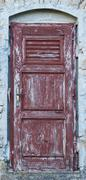 old brown yellow ragged shabby wooden door - stock photo