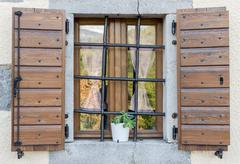 window with open wooden shutters - stock photo