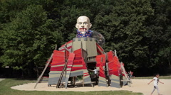 Scary psychedelic vampire face slide in children playground, Berlin, Germany - stock footage