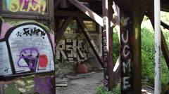 Graffiti in abandoned industrial building - stock footage