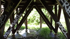 Graffiti under a wooden bridge - stock footage