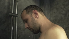 Sad, depressed man under shower, super slow motion, 240fps Stock Footage