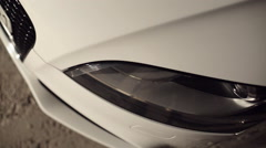 Close-up of car headlights - stock footage