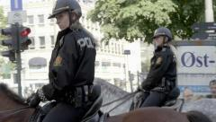 Policewomen on horseback in city of Oslo, editorial Stock Footage