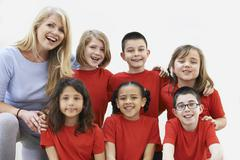 Group Of Children With Teacher Enjoying Drama Workshop Together - stock photo