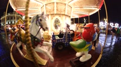 Frightening carousel that spins empty - stock footage