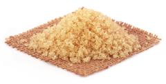 Pile of red sugar - stock photo