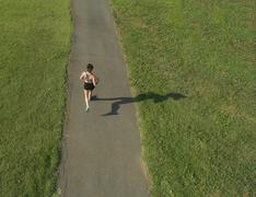 Stock Photo of Female Athlete Running