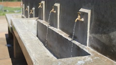 Faucets running side shot Stock Footage
