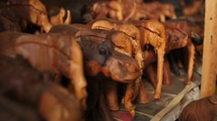 Hand carved animals pull back Stock Footage
