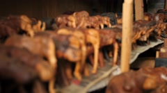 Hand carved animals rack focus Stock Footage