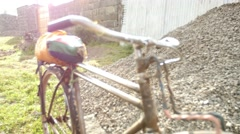 Old bike Kenya rack focus - stock footage