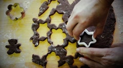 Cutting out gingerbread dough. Traditional Christmas sweet cakes / cookies Stock Footage
