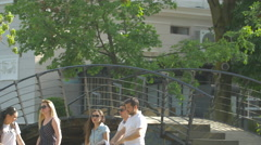 WCrossing a bridge in Central Park, Cluj-Napoca Stock Footage