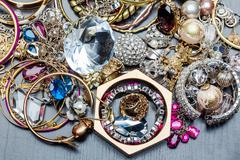 Stock Photo of Many fashionable women's jewelry. Brilliant bangles