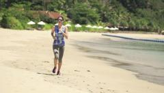 Woman running on beautiful beach, super slow motion, shot at 480fps Stock Footage