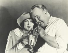 Sharing a milkshake Stock Photos