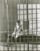 Woman behind bars Stock Photos